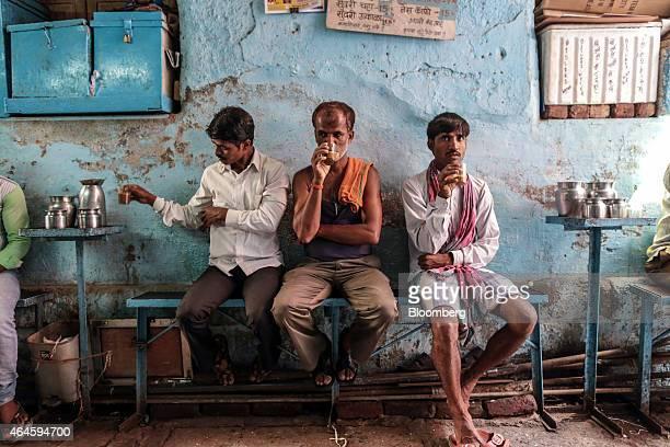Customers sit drinking Indian chai tea at a stall near Crawford Market in Mumbai India on Thursday Feb 26 2015 India's Finance Minister Arun Jaitley...