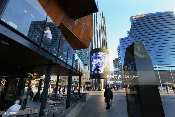 Customers sit in a restaurant left in Yagan Square as the Bankwest Tower stands in the central business district of Perth Australia on Wednesday...