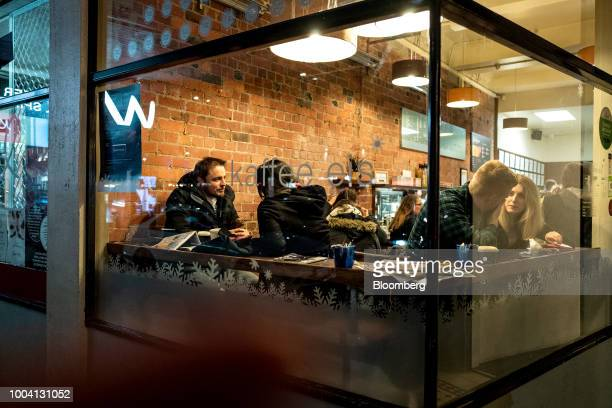 Customers sit inside a Kaffee Eis cafe at Courtney Place in Wellington New Zealand on Tuesday July 17 2018 New Zealand inflation picked up in the...