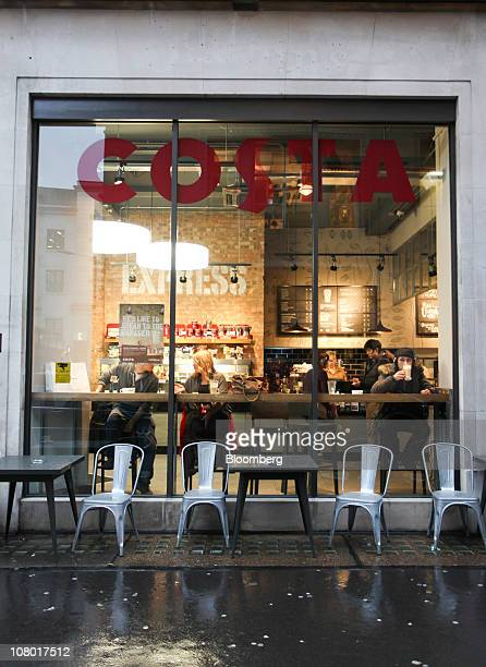Customers sit inside a 'Metropolitan' Costa Coffee shop in London UK on Wednesday Jan 12 2011 Whitbread Plc may be considering buying Coffee Nation a...