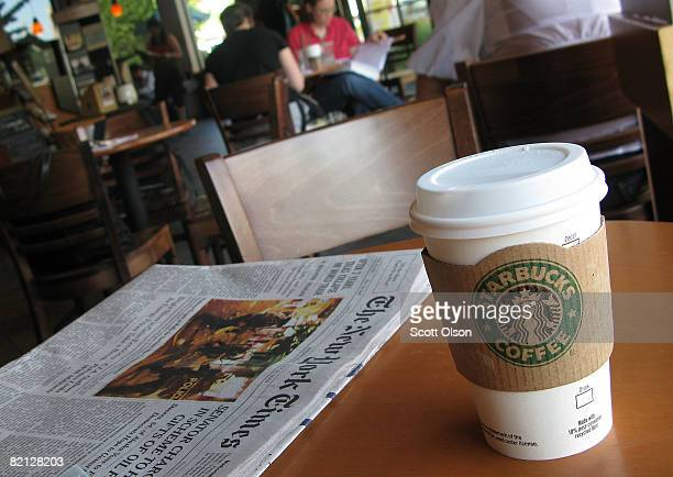 Customers sit inside a Starbucks coffee shop July 30 2008 in Chicago Illinois Starbucks Corp today posted a $67 million thirdquarter loss and lowered...