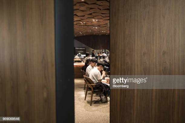 Customers sit inside the Starbucks Corp Reserve Roastery store in Shanghai China on Friday May 11 2018 Starbucksis laying out an ambitious plan to...