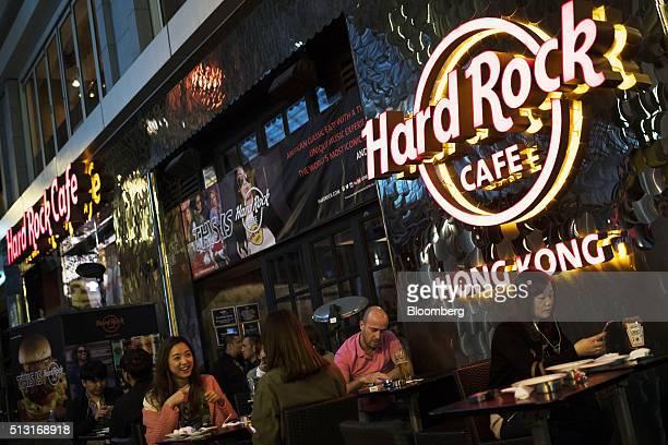 Customers sit on a terrace at the Hard Rock Cafe Hong Kong operated by Hard Rock International Inc in Hong Kong China on Monday Feb 29 2016 Hard Rock...