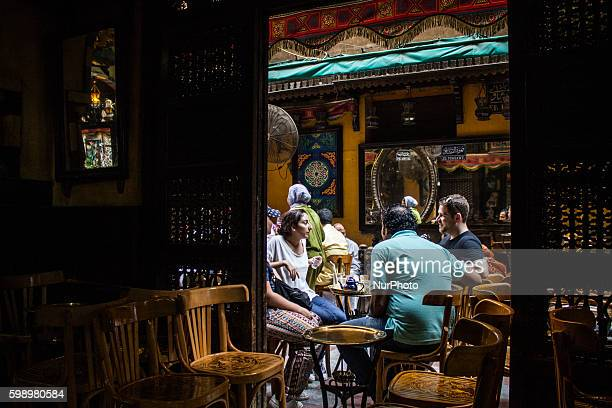 Customers sit outside the alFishawi cafe in Khan alKhalili bazaar Cairo Egypt 02 Sep 2016 AlFishawi is Egypt's most famous coffee shop The cafe...