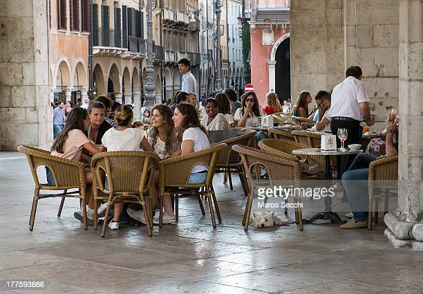 Customers sits at a cafe in the city centre on August 24, 2013 in Treviso, Italy. Treviso claims that Tiramisu was invented in the 1960s by Alba...