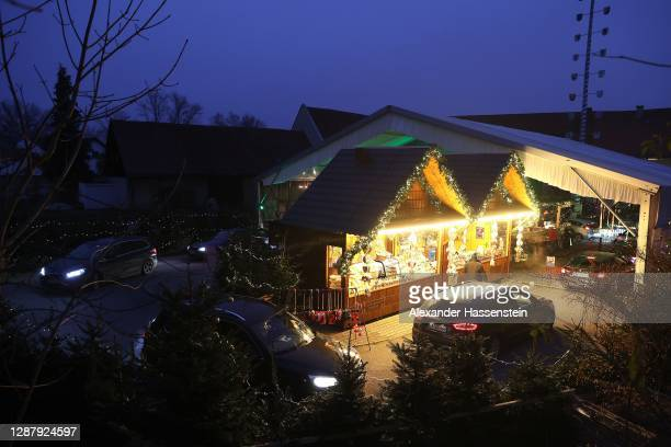 Customers sitting in their cars receiving goods at a drive-in Christmas market during the second wave of the coronavirus pandemic on November 26,...