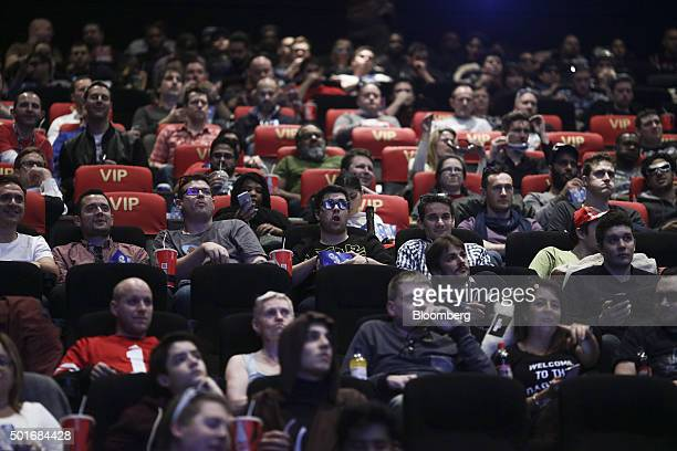 Customers sitting in their seats await the first public screening of Walt Disney Co's Star Wars The Force Awakens at a Vue Entertainment Ltd cinema...