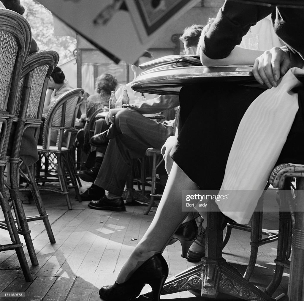 Customers sitting on the terrace of a cafe on the Champs-Elysees, Paris, June 1951. Original publication: Picture Post - 5343 - Sunday Morning In The Champs-Elysees - pub. 23rd June 1951
