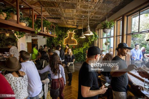 Customers smoke marijuana at the Lowell Cafe, a new cannabis lounge, in West Hollywood, California, U.S., on Tuesday, Oct. 1, 2019. America's first...