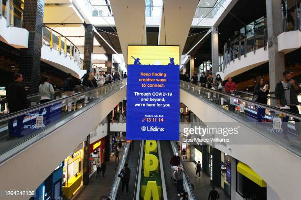 Customers social distance on a travelator at Broadway Shopping Centre on August 06, 2020 in Sydney, Australia. Mirvac Retail has mandated masks be...