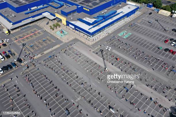 Customers socially distance themselves as the queue to enter Ikea Warrington The store opening saw large queues of people and traffic on adjacent...