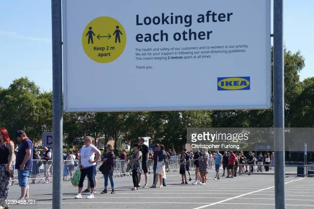 Customers socially distance themselves as they queue to enter Ikea Warrington The store opening saw large queues of people and traffic on adjacent...