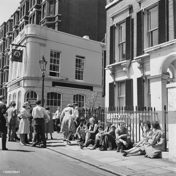 Customers spill out onto the pavement on a busy Sunday morning at the The King's Head and Eight Bells pub on Cheyne Walk Chelsea London September 1959