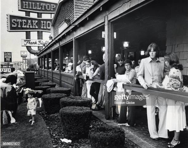 Customers stand around with drinks in hand from the outer bar while waiting for a table at the Hilltop Steakhouse in Saugus Mass July 14 1978