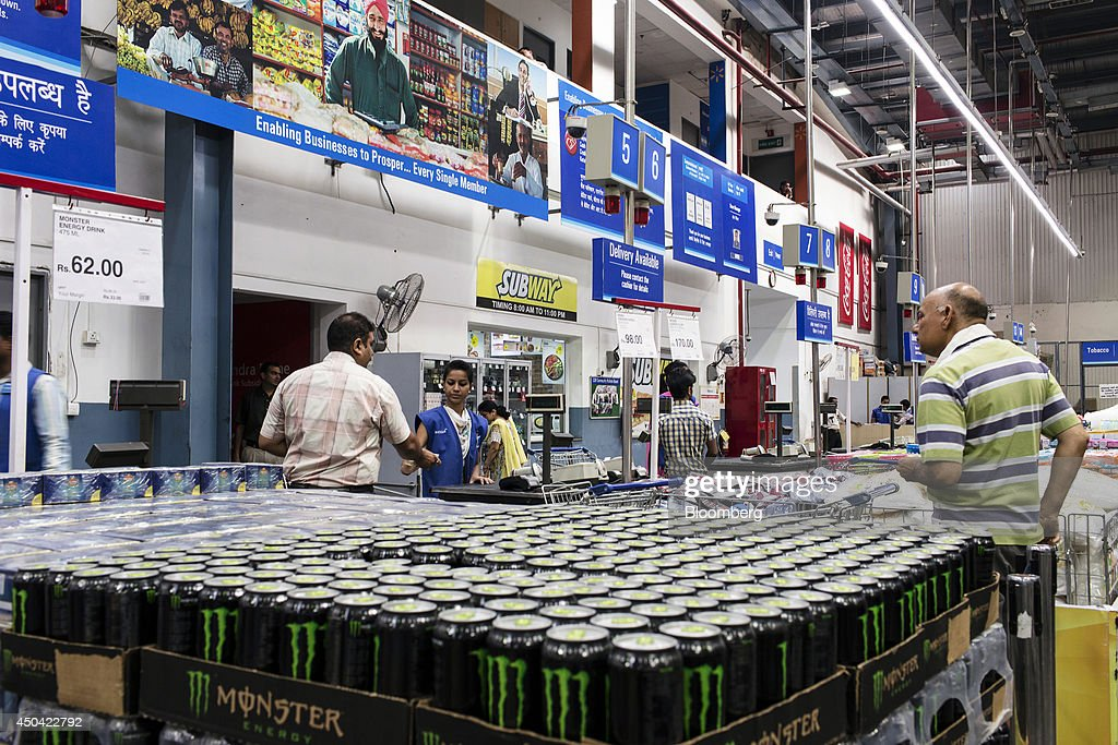 Customers stand at a checkout counter inside a Walmart India Pvt Best Price Modern Wholesale store in the town of Zirakpur on the outskirts of...