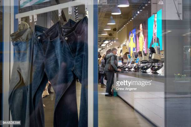 Customers stand at the checkout counter at an Old Navy store in the Herald Square neighborhood of Manhattan April 11 2018 in New York City US...