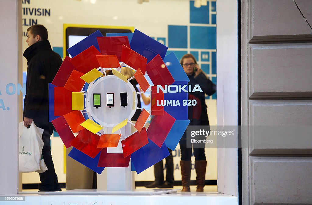 Customers stand behind a window display of Lumia 920 smartphones in a Nokia Oyj store in Helsinki, Finland, on Thursday, Jan. 17, 2013. The pace of Finland's debt growth is alarming and the country must undertake economic reforms together with reining in spending, Finnish Prime Minister Jyrki Katainen said in an op-ed piece published in newspaper Savon Sanomat. Photographer: Ville Mannikko/Bloomberg via Getty Images