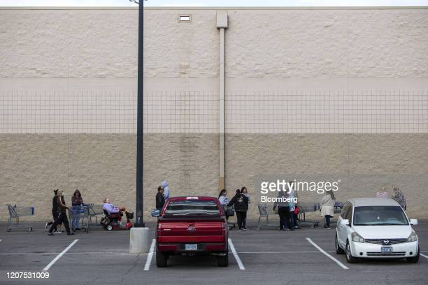 Customers stand in line outside a Sam's Club ahead of opening hours in Las Vegas, Nevada on Tuesday, March 17, 2020. No one has a handle on how vast...