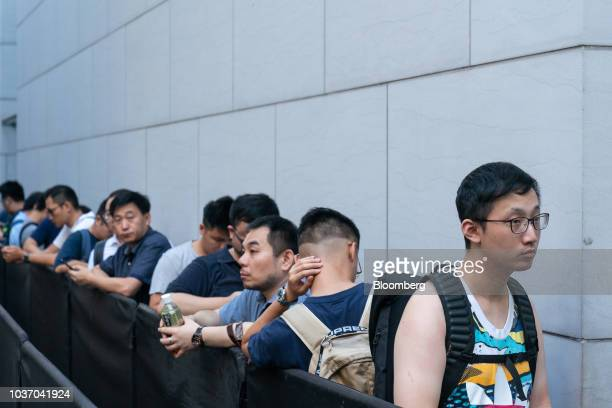 A customer looks at an Apple Inc Watch Series 4 device on display at an Apple store during its launch in Hong Kong China on Friday Sept 21 2018 The...