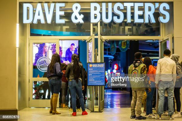 Customers stand in line to enter a Dave & Buster's Entertainment Inc. Location in Pelham, New York, U.S. On Friday, March 24, 2017. Dave & Buster's...