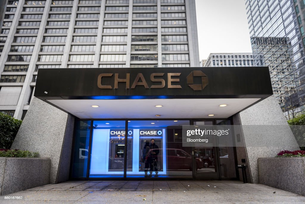 Customers stand inside a JPMorgan & Chase bank branch automated