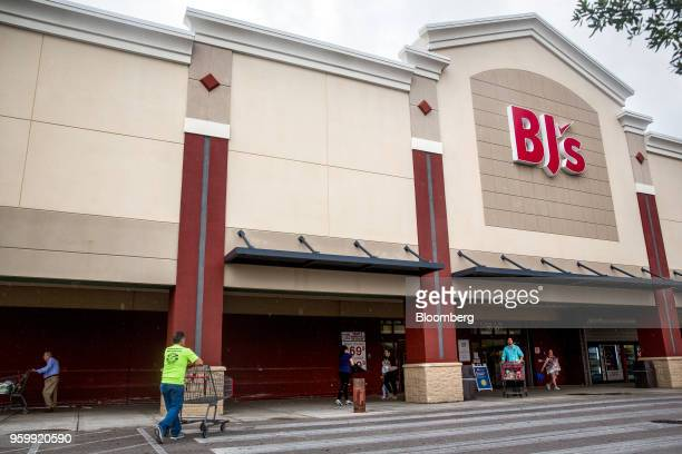 Customers stand outside a BJ's Wholesale Club Holdings Inc location in Miami Florida US on Thursday May 17 2018 The warehouseclub chain which had...