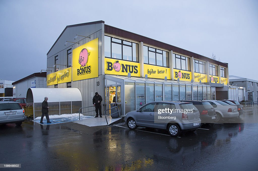 Customers stand outside the entrance to a Bonus grocery store, owned by Baugar Group hf, in Reykjavik, Iceland, on Wednesday, Jan. 2, 2013. Creditors of Iceland's three biggest failed banks are fighting for a waiver to krona controls imposed in 2008 amid risks pay-outs will be delayed beyond 2015. Photographer: Arnaldur Halldorsson/Bloomberg via Getty Images