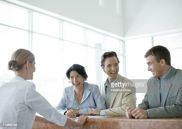 Customers standing at counter, laughing