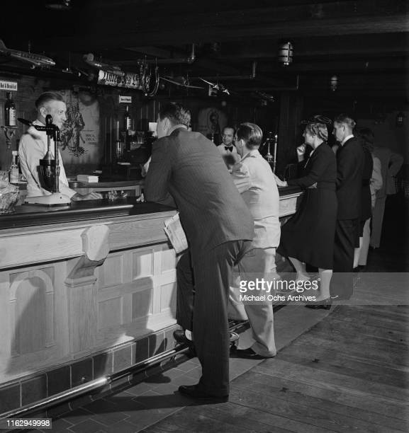 Customers standing at the bar in the 21 Club restaurant and speakeasy on West 52nd Street in New York City US September 1945