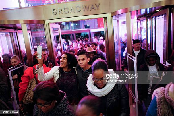 Customers stream into Macy's flagship store in Herald Square on Thanksgiving evening for early Black Friday sales on November 26 2015 in New York...