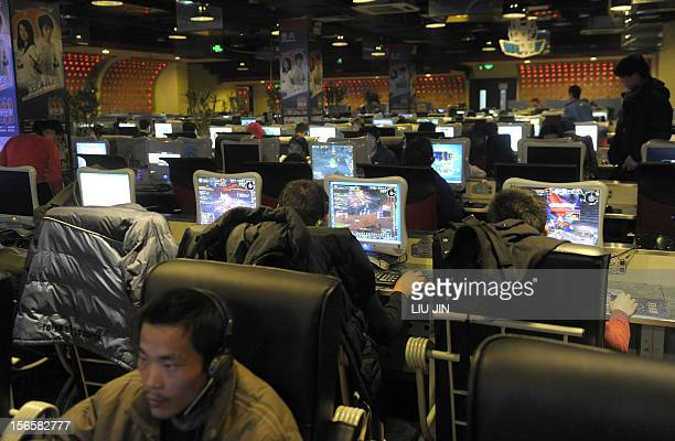 Customers surf the internet at an internet bar in Beijing on January 15 2009 China is casting an increasingly wary eye over the Internet and its 50...