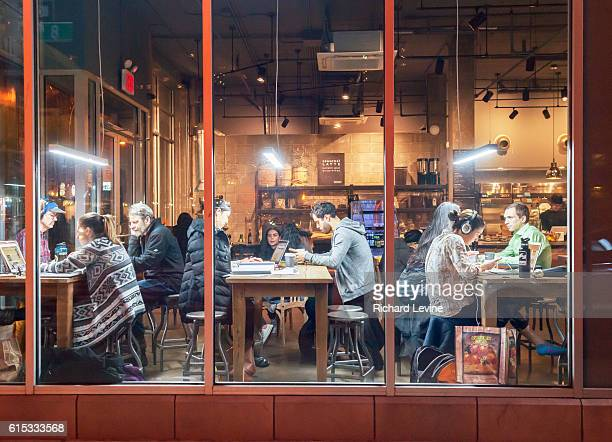 Customers take advantage of free wifi in the Bean Bean Coffee shop in Chelsea in New York on Tuesday March 22 2016 The free wifi and the communal...