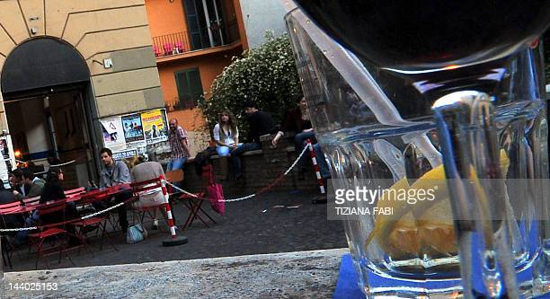 Customers take the aperitif in a bar in Rome on April 27 2012 Many Italian bars offer an 'Aperitivo' with an all you can eat buffet instead of a...