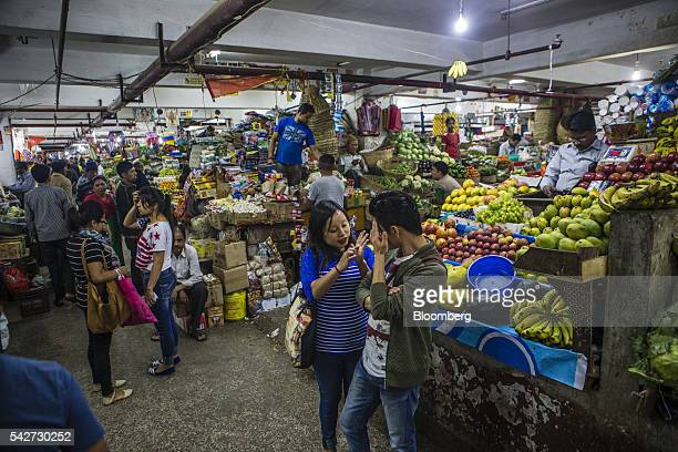 Customers talk in a fruit and vegetable market in Gangtok Sikkim India on Monday May 2 2016 Yearonyear growth in Asia's thirdlargest economy...