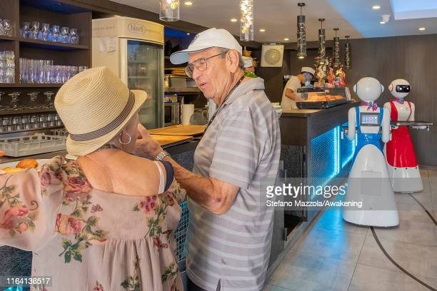 Customers talk while waiters robots wait near the kitchen on July 25 2019 in Rapallo Italy The Gran Caffè Rapallo restaurant in Liguria is the first...