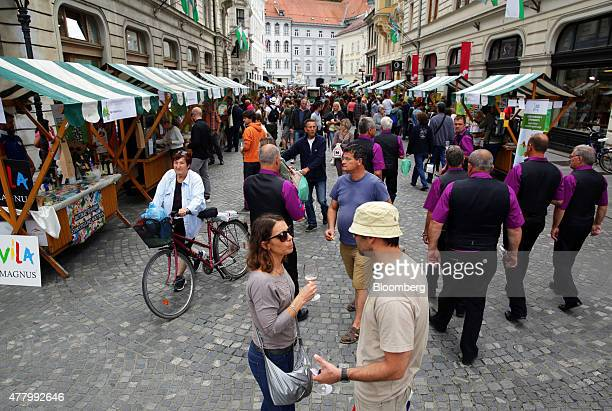 Customers taste local wine and browse goods at an organic food and drink festival in Ljubljana Slovenia on Saturday June 2015 Slovenia rejected...