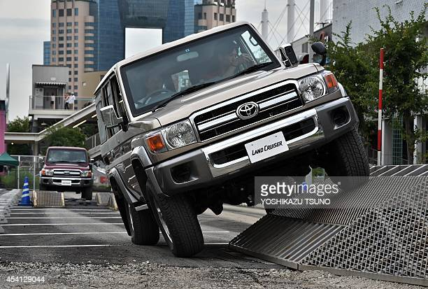 """Customers test-drive Japan's auto giant Toyota Motor's 30th anniversary model of """"Land Cruiser 70"""", equipped with a 4.0-litter V6 engine to drive..."""