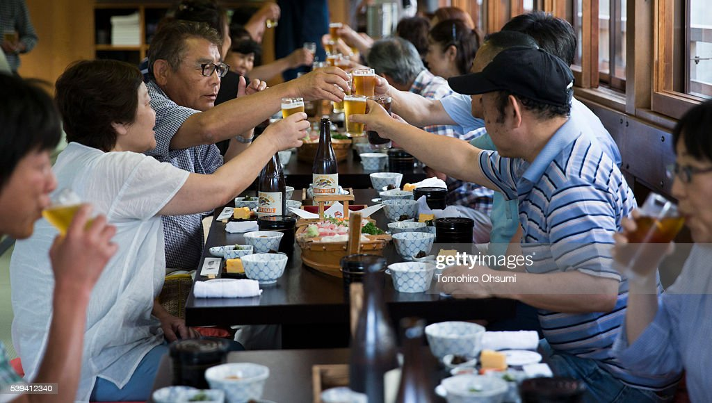 Customers toast inside a yakatabune, or traditional low barge style boat, operated by Mikawaya shipping agent, as it sails through Tokyo Bay on June 11, 2016 in Tokyo, Japan. About 35 companies operate over 100 yakatabune boats in Tokyo offering services such as dinner or karaoke inside the boats while cruising in Tokyo's bay area, according to the Tokyo Yakatabune Association.