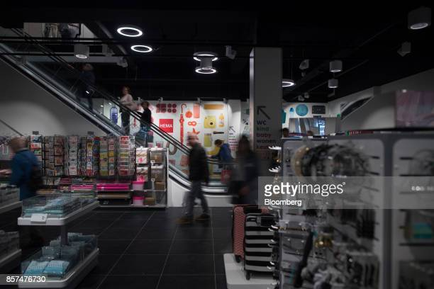 Customers travel on an escalator inside a Hema BV store in Tilburg Netherlands on Wednesday Oct 4 2017 Privateequity firm Lion Capital LLP which...