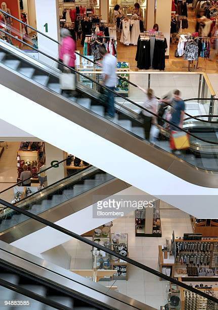 Customers travel up escalators in a John Lewis department store at the Bluewater Shopping Centre in Kent UK on Thursday June 26 2008 UK retail sales...
