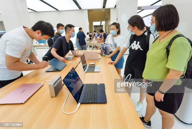Customers try out Huawei Matebook X laptop computers at a Huawei flagship store after a Huawei Technologies Co. Launch event on August 19, 2020 in...