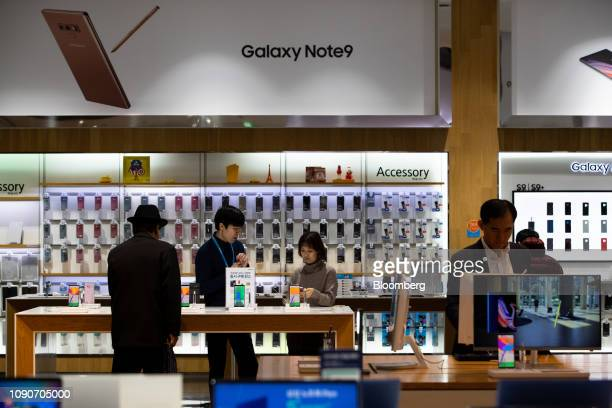 Customers try out Samsung Electronics Co Galaxy Note 9 smartphones at the company's D'light flagship store in Seoul South Korea on Monday Jan 28 2019...
