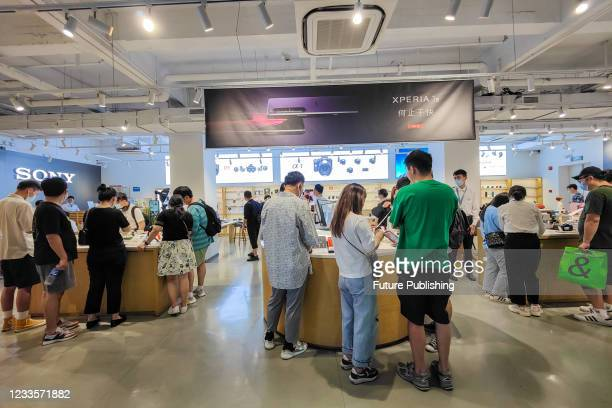 Customers try out Sony products in the flagship store of Sony in Shanghai, China, June 20, 2021.