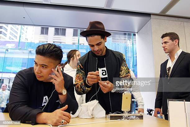 Customers try out the iPhone 6 at the Apple Inc. George Street store during the sales launch of the iPhone 6 and iPhone 6 Plus in Sydney, Australia,...