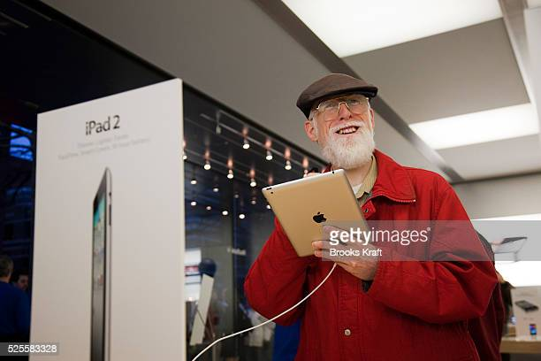 Customers try out the new Apple iPad 2 tablet at an Apple Store in Bethesda MD