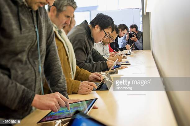 Image was created using a variable planed lens Customers try the Apple Pencil with the new iPad Pro displayed at a store in San Francisco California...