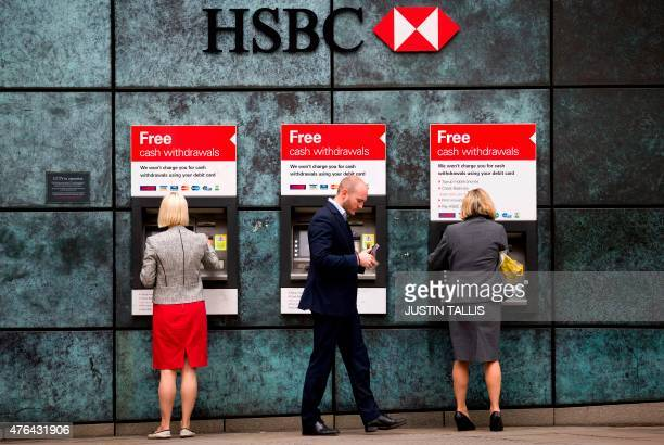 Customers us ATM cashpoints outside a HSBC bank branch in London on June 9 2015 Scandalhit bank HSBC said it would cut its global headcount by up to...