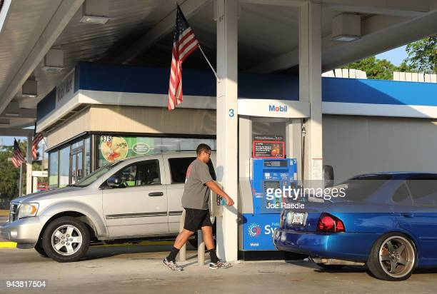Customers use a gas station as reports indicate that the price of gasoline continues to rise on April 9 2018 in Miami Florida AAA forecasts the...