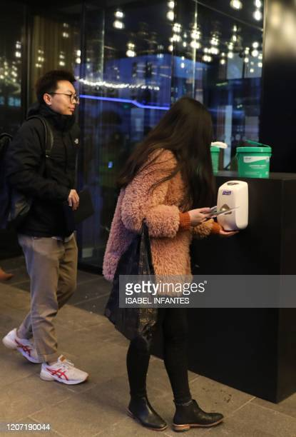 Customers use a hand sanitiser before attending a screening of the European Premiere of Disney's MULAN at the Odeon Luxe Leicester Square cinema in...