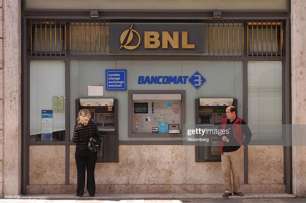 Banco Nationale Di Lavoro : Customers use an atm at branch of the banca nazionale del la